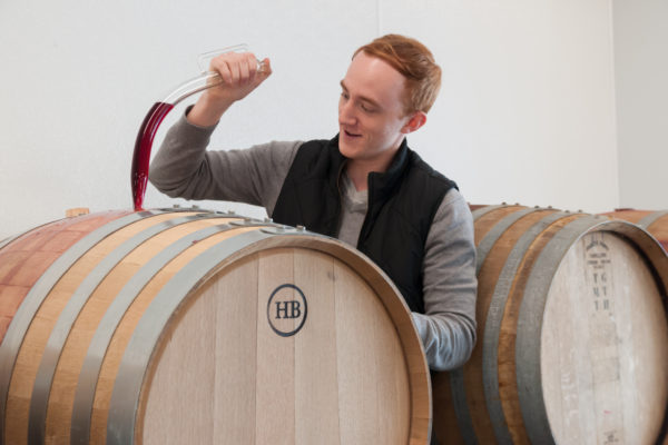groom drawing wine from barrel