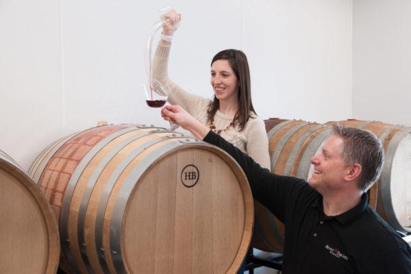 drawing wine from wedding barrel